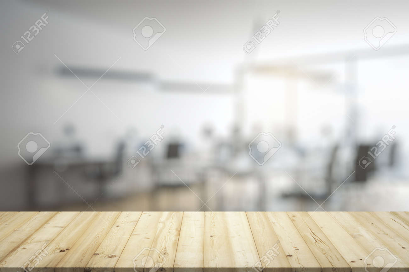 Blank wooden table top with light furnished office on background, mockup - 159200774