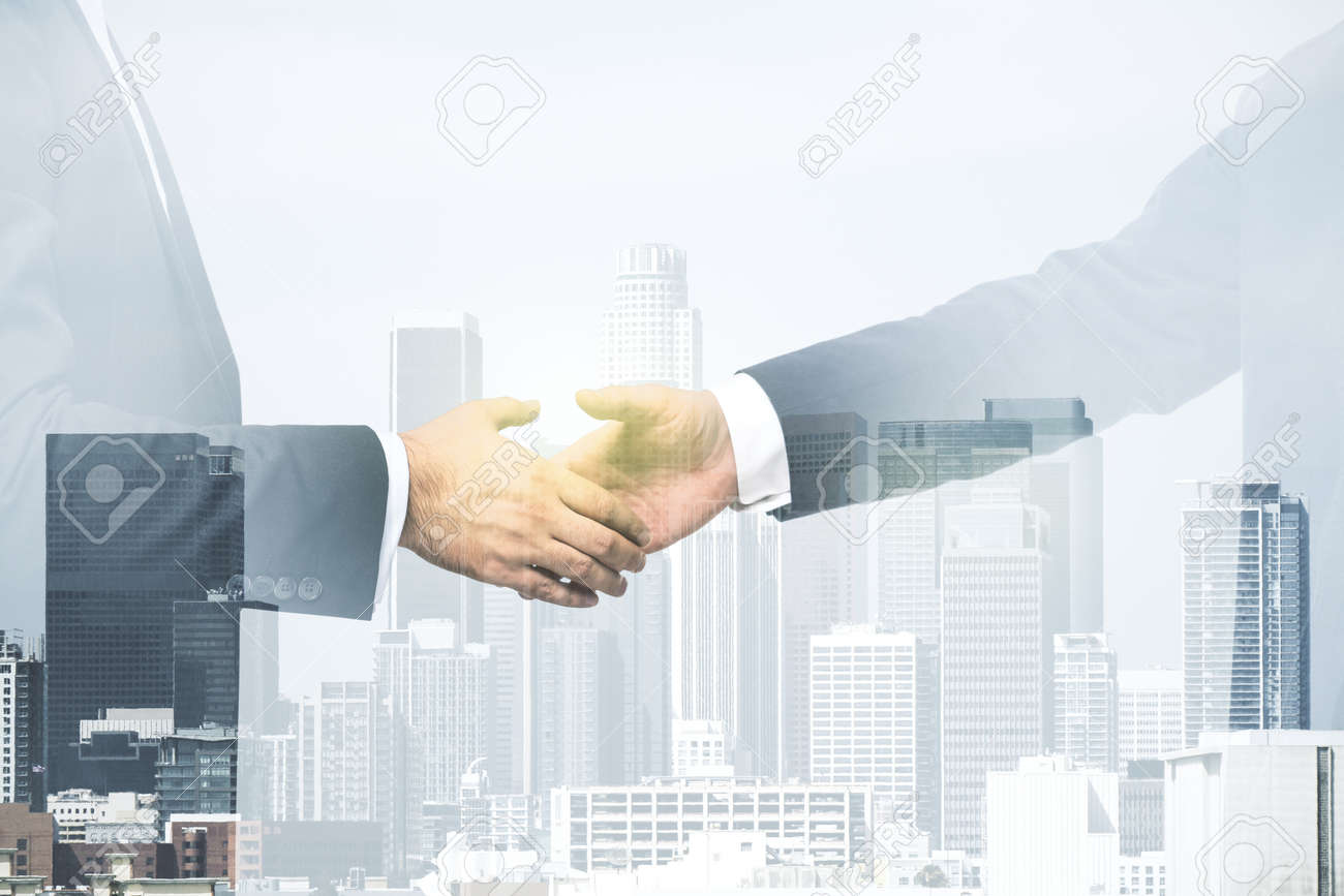Double exposure of handshake two businessmen on modern skyscrapers background, research and strategy concept - 169781562
