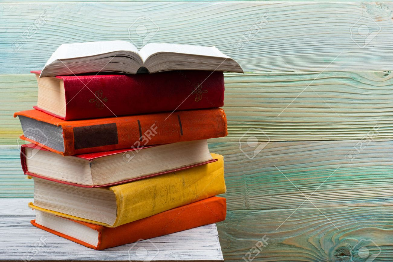 Open book, hardback books on wooden table. Back to school. Copy space. - 50995488