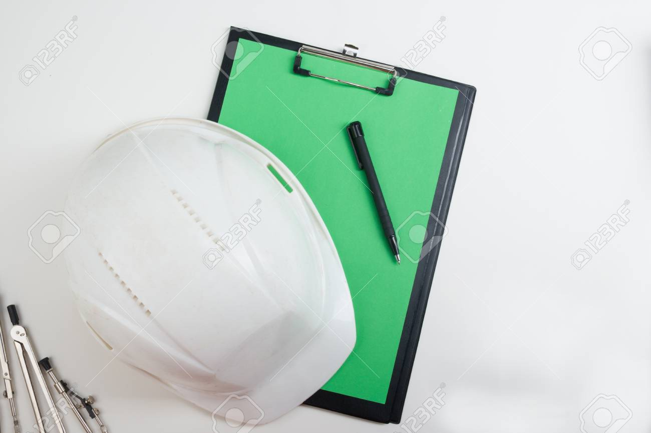 Workplace of architect architectural project plan blueprint stock photo workplace of architect architectural project plan blueprint rolls and pen safety helmet on blank sheet of paper malvernweather Image collections