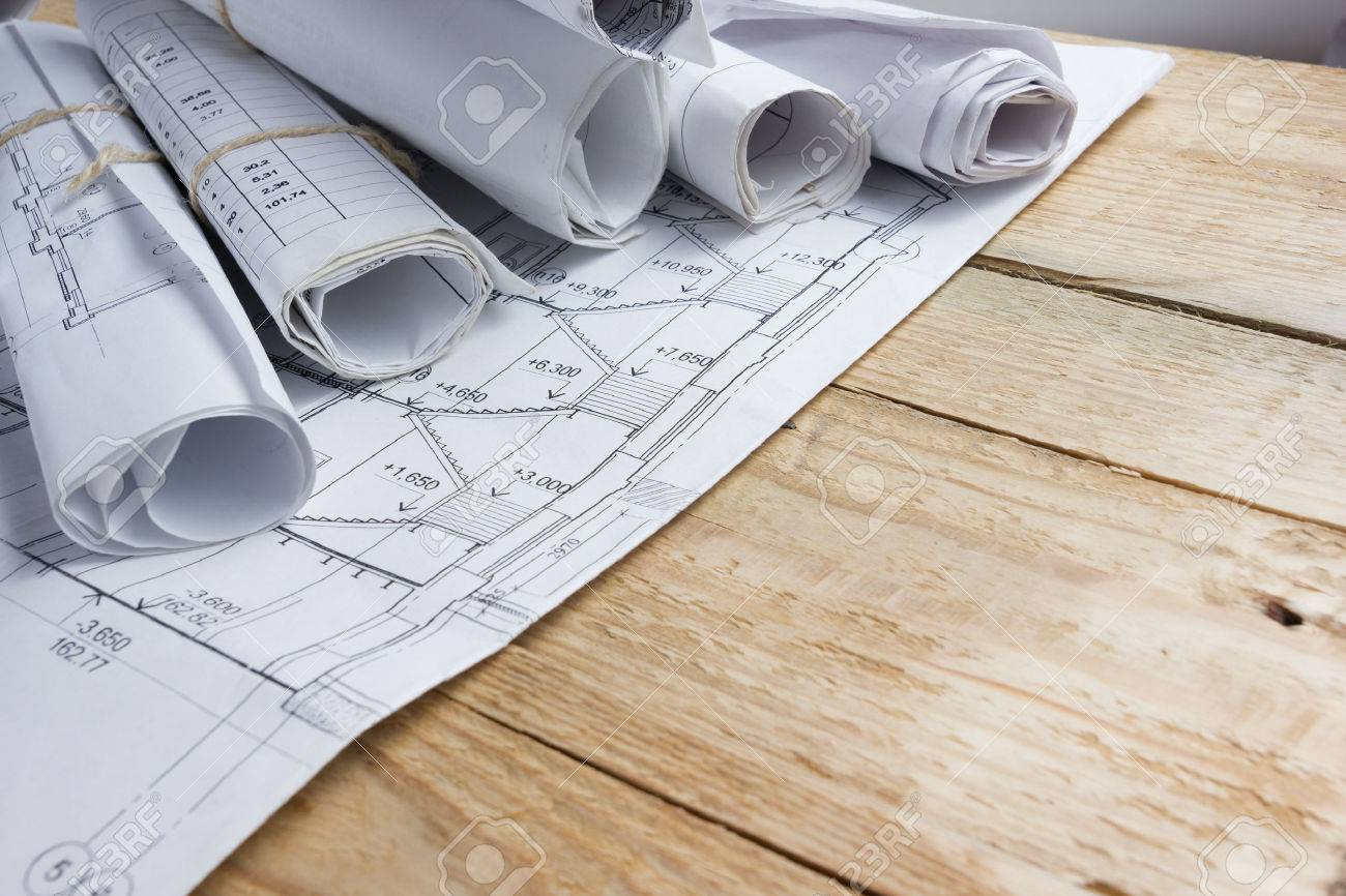 Architectural project blueprints blueprint rolls and divider architectural project blueprints blueprint rolls and divider compass calipers on vintage wooden background malvernweather Images