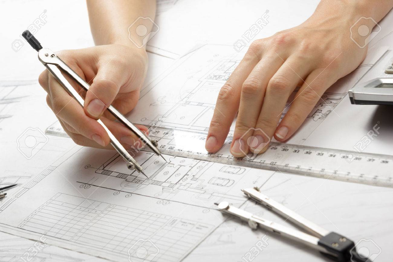 Architect working on blueprint architects workplace architectural architect working on blueprint architects workplace architectural project blueprints ruler calculator malvernweather Image collections
