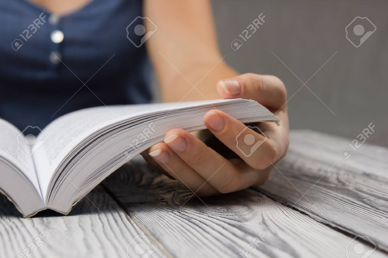 Closeup hand open book for reading concept background. - 51812926