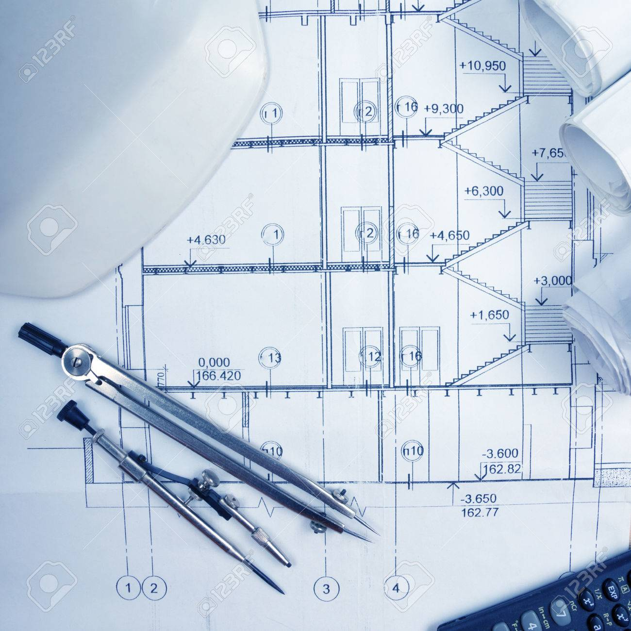 Architectural blueprints blueprint rolls compass divider architectural blueprints blueprint rolls compass divider calculator white safety on graph paper malvernweather Gallery