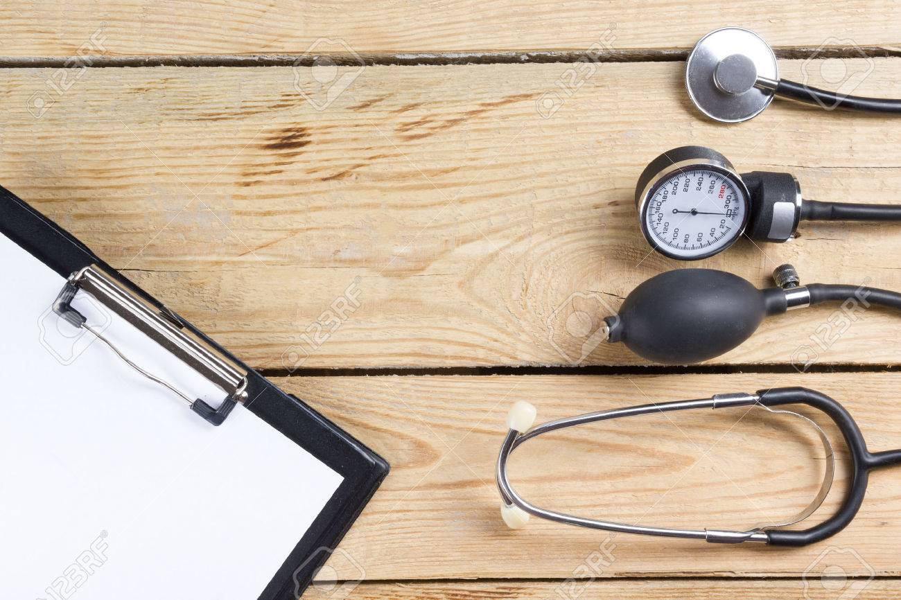Medical Clipboard And Stethoscope On Wooden Desk Background ...