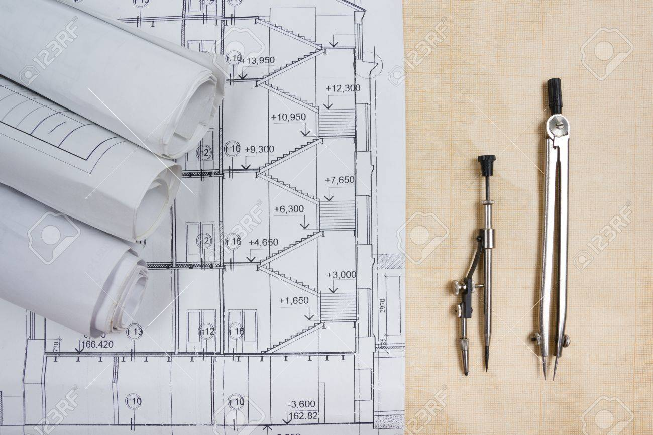Architectural blueprints blueprint rolls compass divider construction background architectural blueprints blueprint rolls compass divider calculator white safety on graph paper malvernweather Images