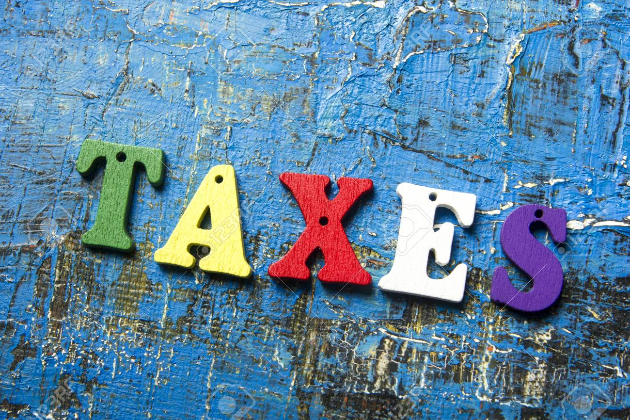 Lettere Di Legno Colorate : Immagini stock testo tasse su lettere di legno colorate. abc di