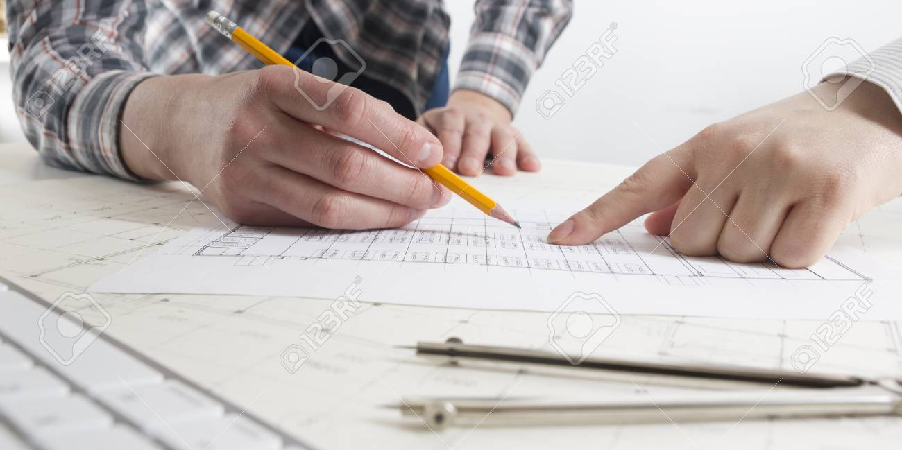 Architects working on blueprint architects workplace architects working on blueprint architects workplace architectural project blueprints ruler calculator malvernweather Image collections