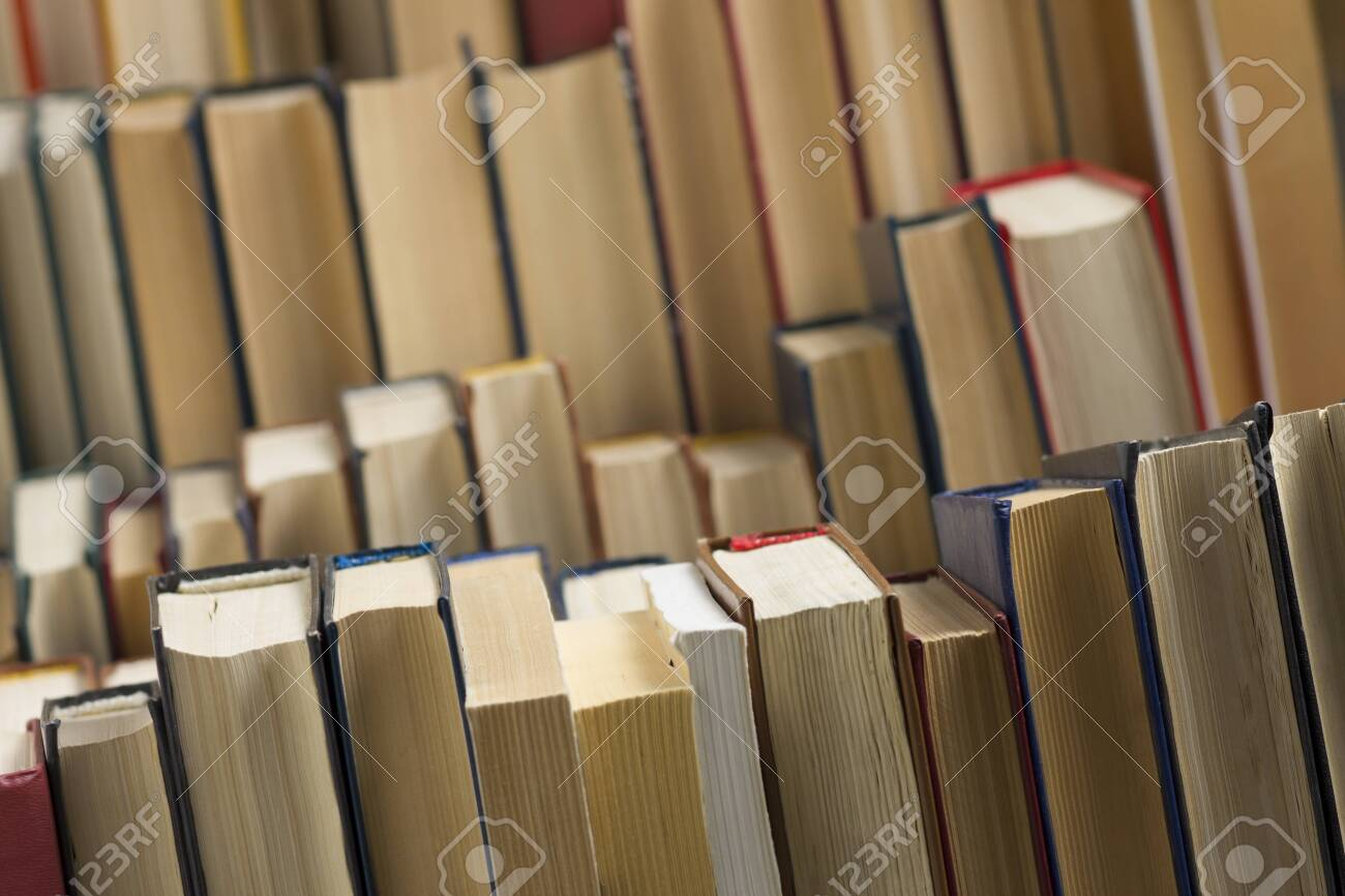 Stack of books background. many books piles. - 130107331