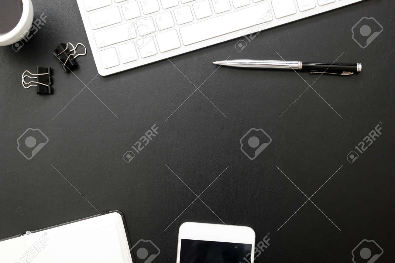 Black desk office with laptop, smartphone and other work supplies with cup of coffee. Top view with copy space for input the text. Designer workspace on desk table essential elements on flat lay - 146891735