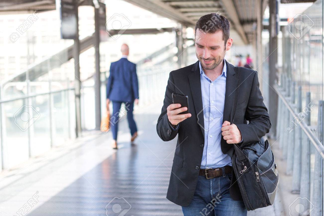 View of a Young attractive business man using smartphone - 46288822