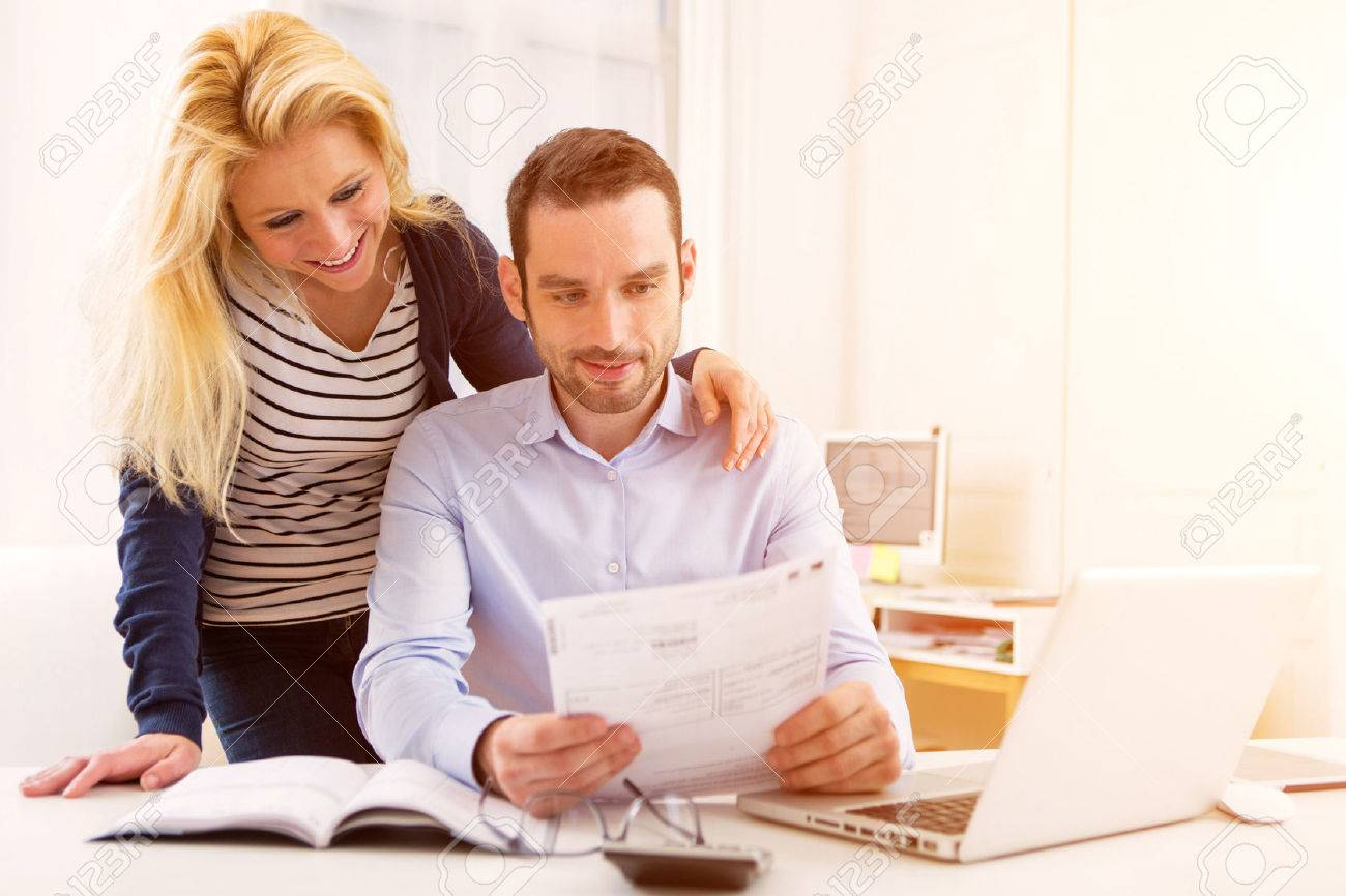 View of a Attractive couple doing administrative paperwork - 51646154