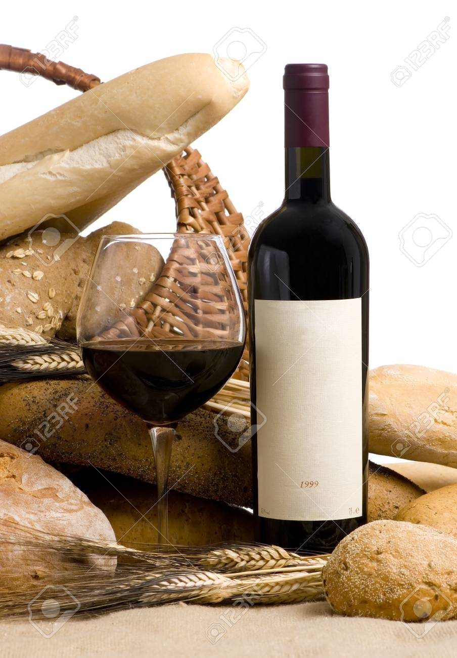 A glass of wine and assorted breads. The wine bottle has a blank lable that can be filled in. Stock Photo - 670502