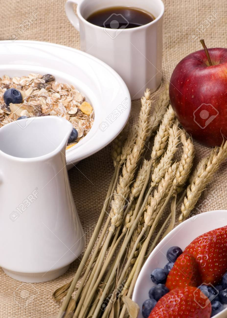 A bowl of muslin cereal with fresh fruits and coffee Stock Photo - 765605