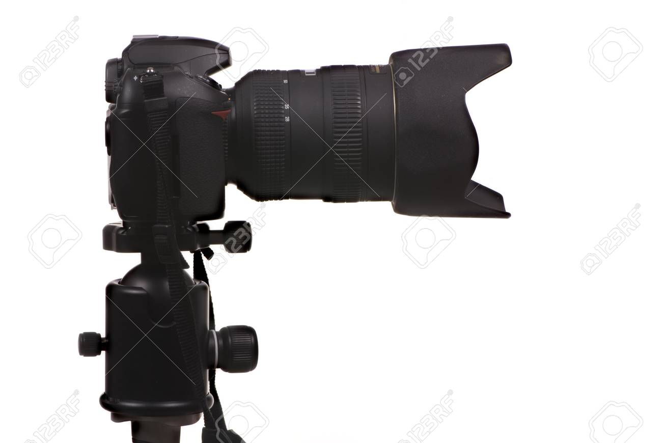 A professional DSLR digital camera, mounted on a tripod and ready to shoot Stock Photo - 792527