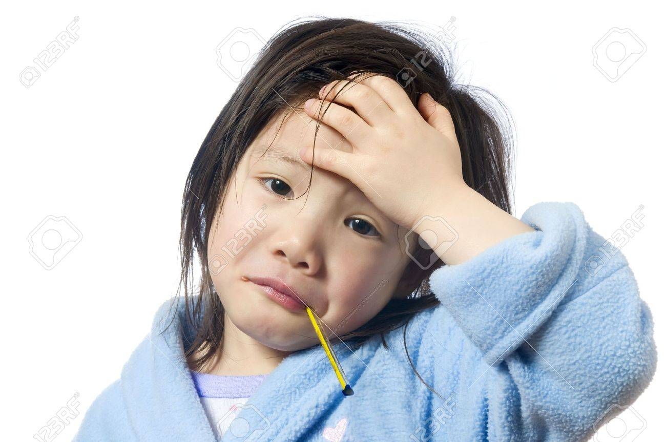 A young girl is sick and having her temperature taken. Stock Photo - 3482234