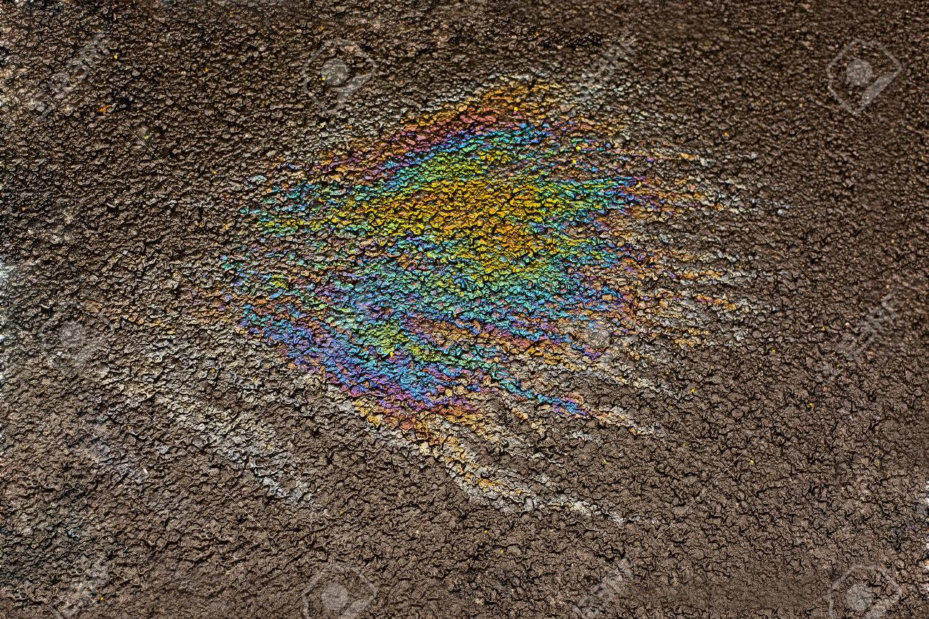 oil spill on the road detail - 51753180