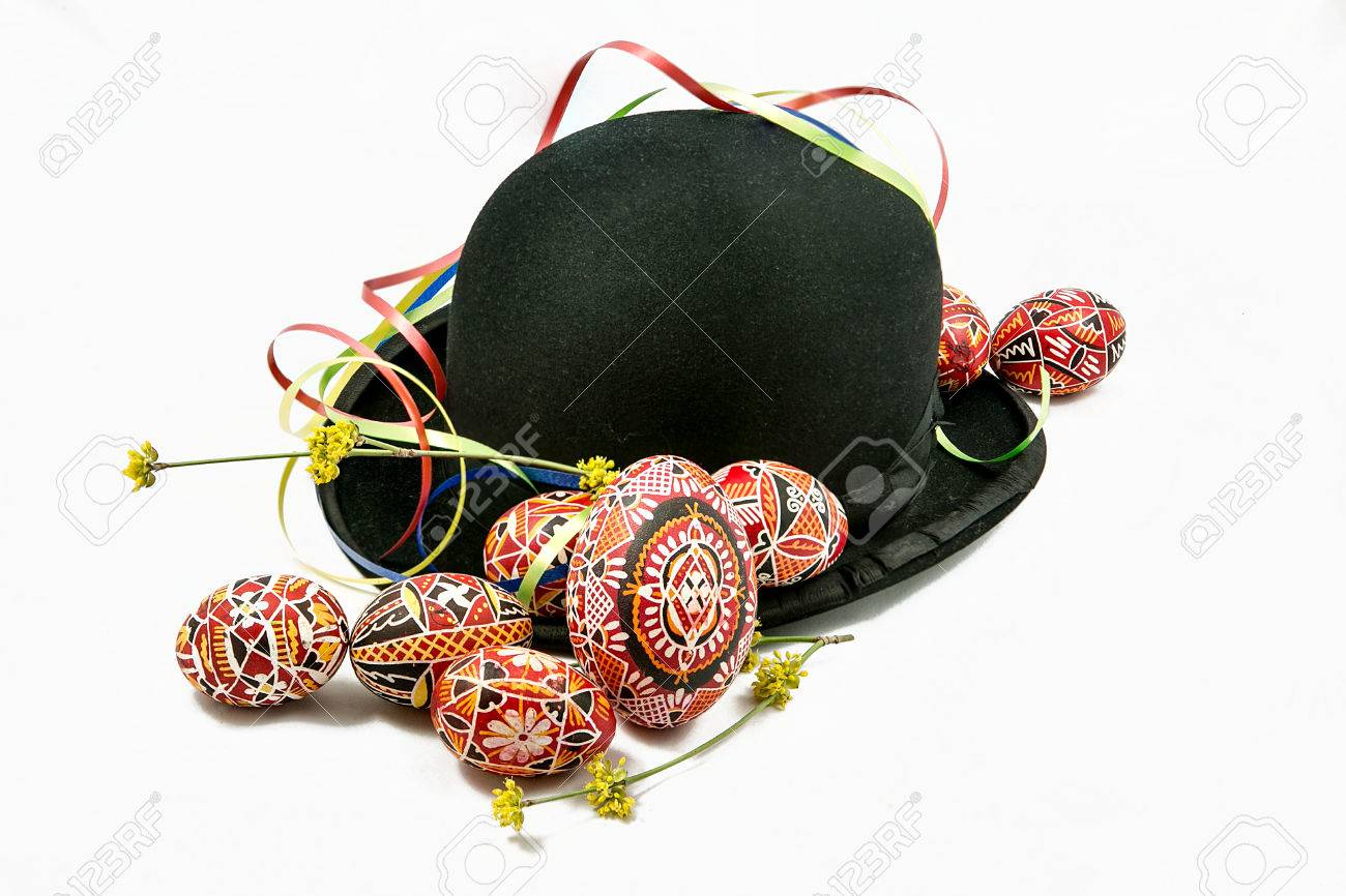 Easter eggs and bowler hat on white background - 56195529