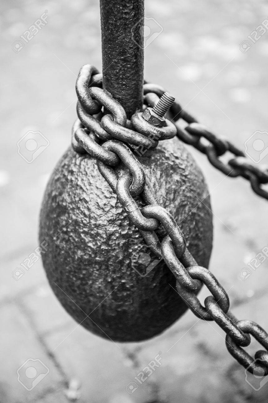 Very old steel weight and chain close up - 62058280