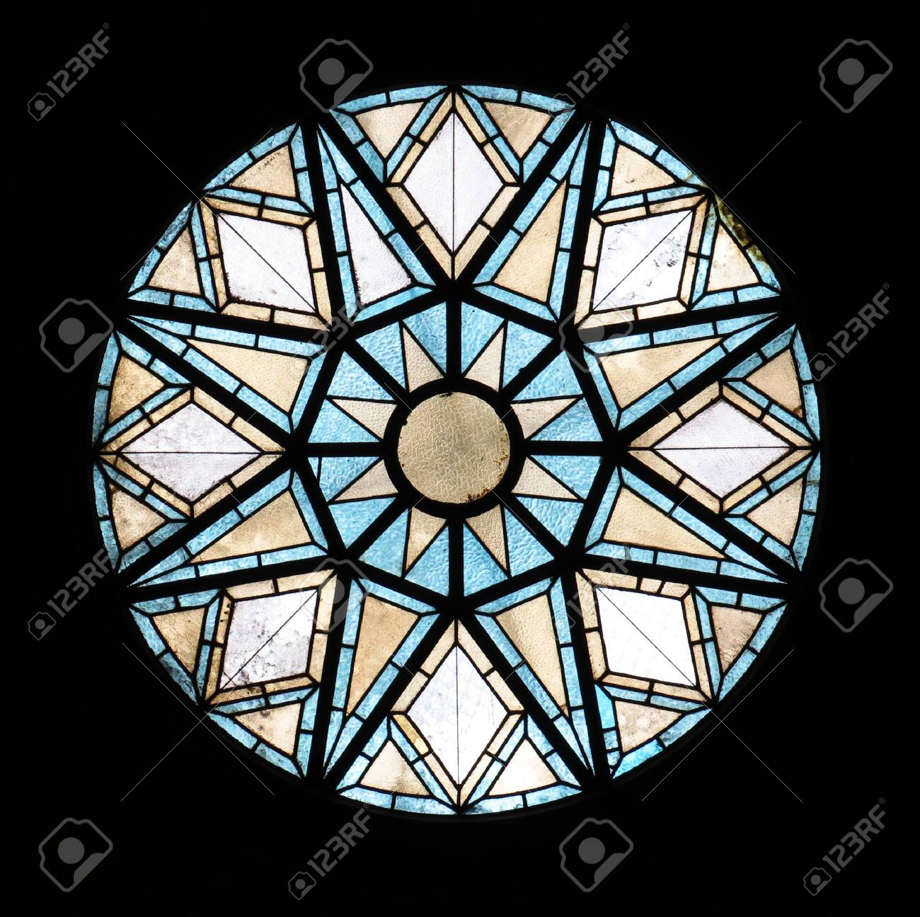 Beautiful old glass window at the ceiling of the Placa D'Antonio Lopez post office in Barcelona. - 132520354
