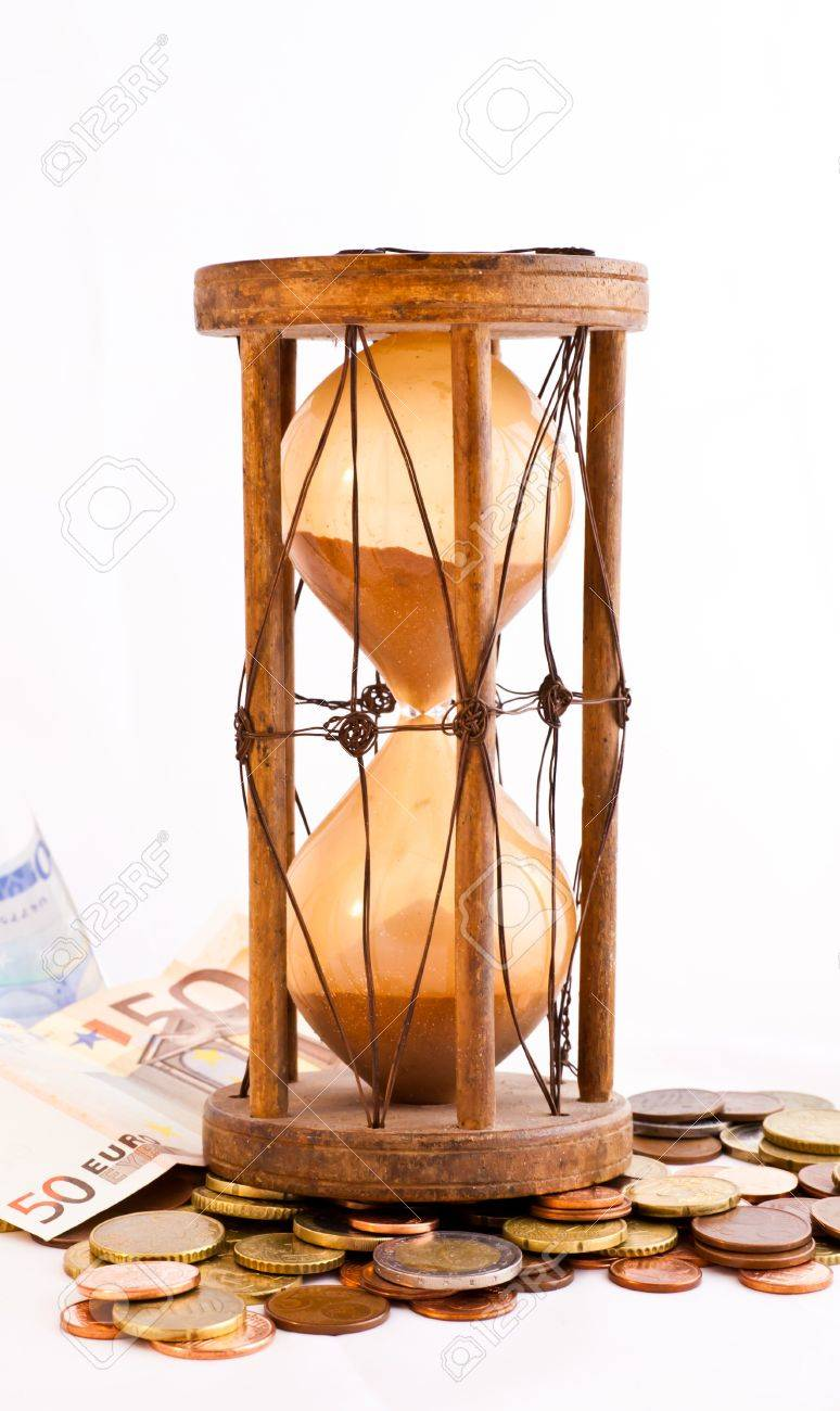 Old hourglass (made in India, XIX century) with euros Stock Photo - 9755811
