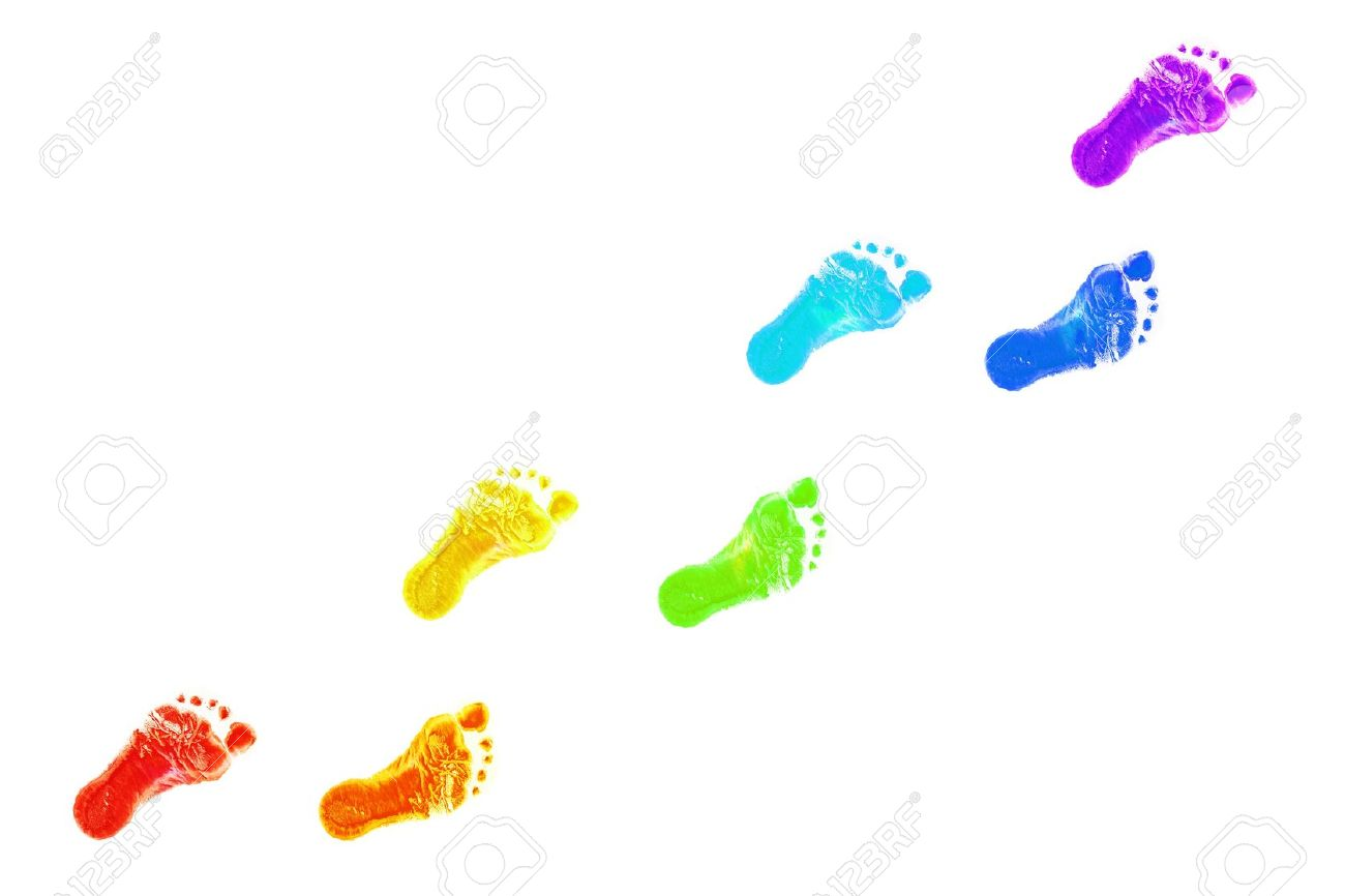 Baby foot prints all colors of the rainbow. The joyful journey. Isolated on white background Stock Photo - 18119401