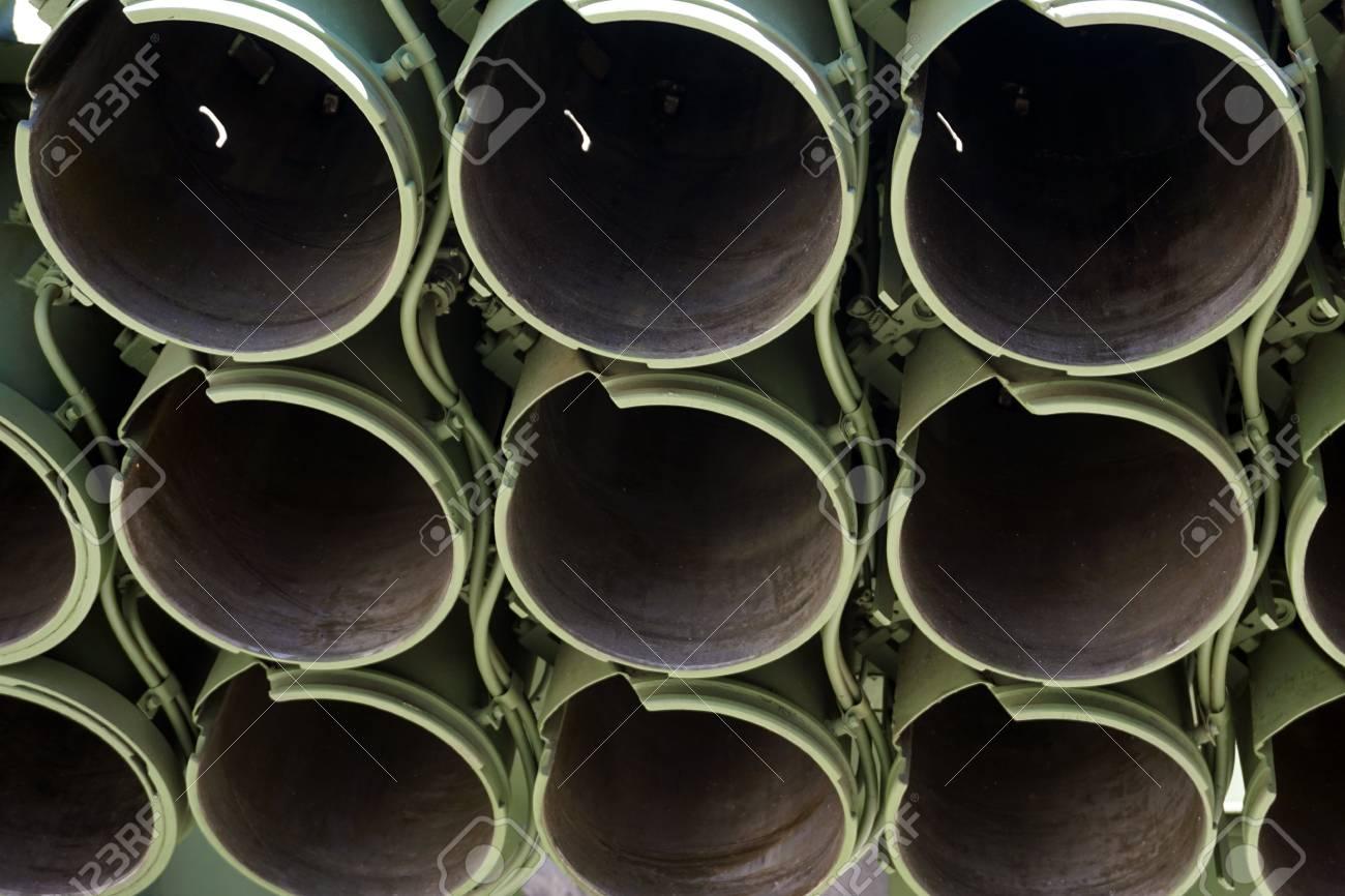Muzzles barrels of military tank artillery gun  copy space, selective