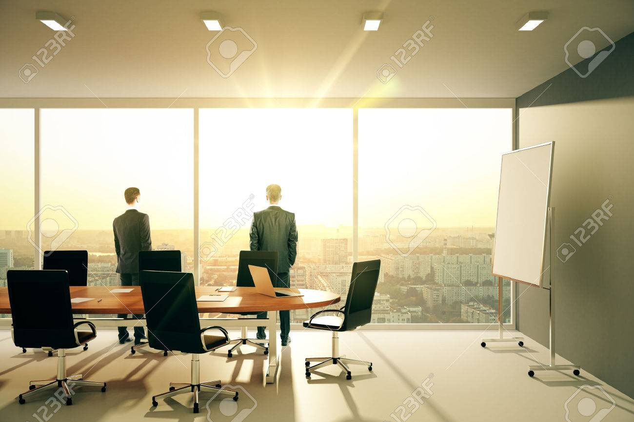 Businessmen In Sunny Conference Room With Furniture And Cityview  # Muebles Sunnies