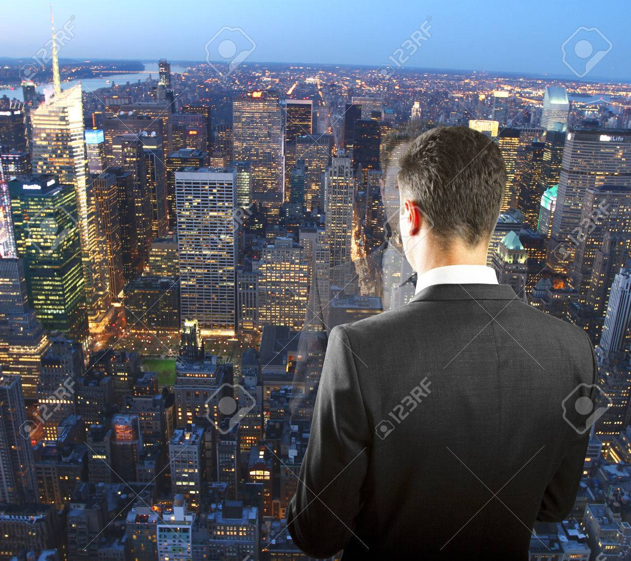 Businessman On The Top Of Skyscraper Looking At Night Megapolis City Stock Photo