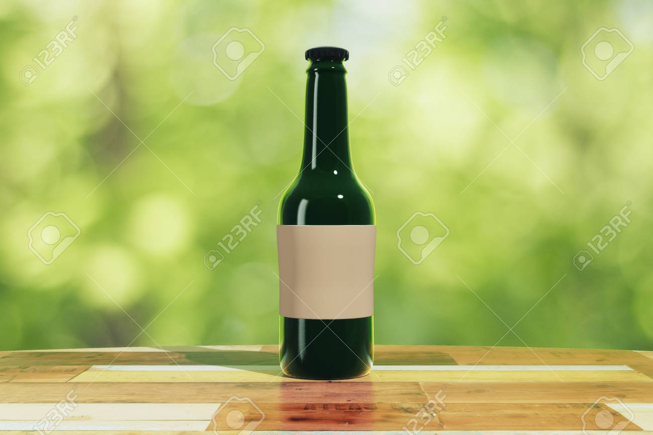 Black bottle with blank sticker on wooden table outdoor, mock