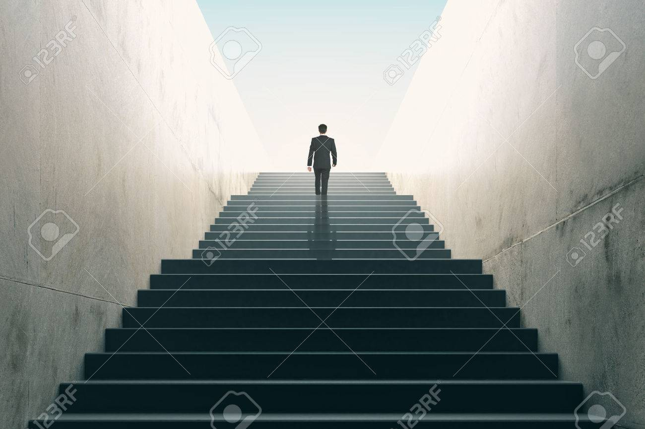Ambitions concept with businessman climbing stairs - 51533375