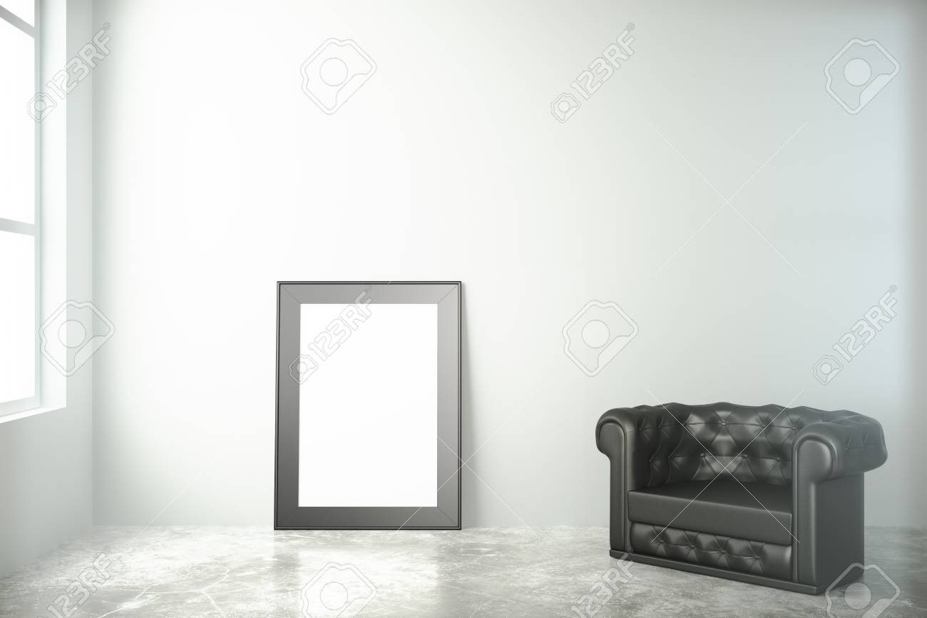 b10a27cb1fc Blank black picture frame on concrete floor with leather chair in empty  room