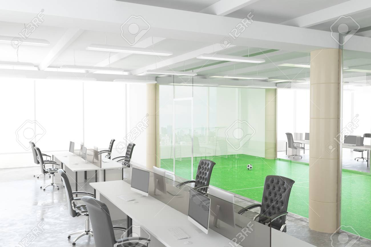 Ufficio Open Space Yoga : Modern open space office with football field behind the transparent