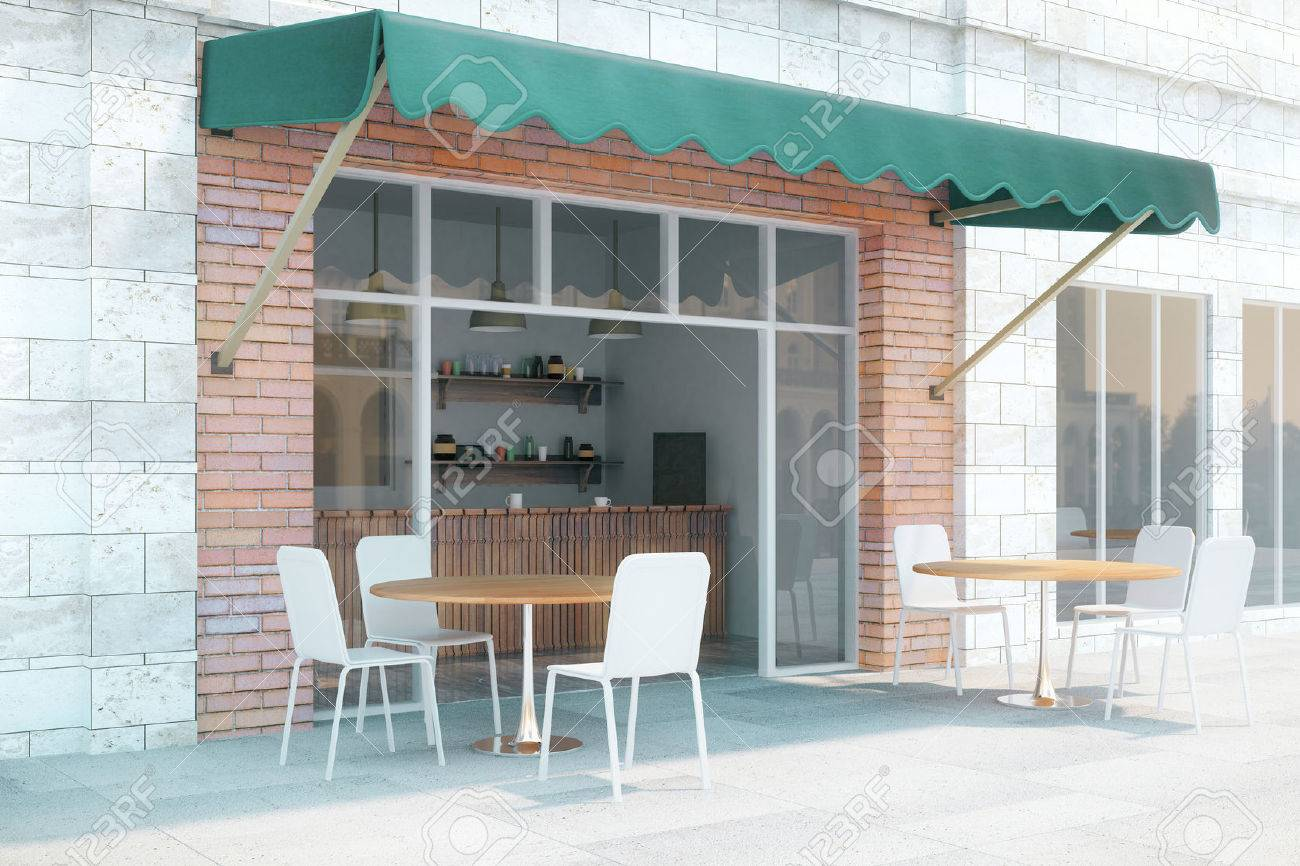 small cafe with brick walls and green canopy exterior design