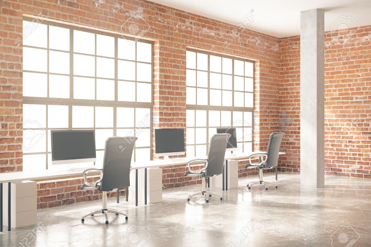 Side View Of Coworking Office Interior With Computers, Concrete Floor, Red  Brick Walls,