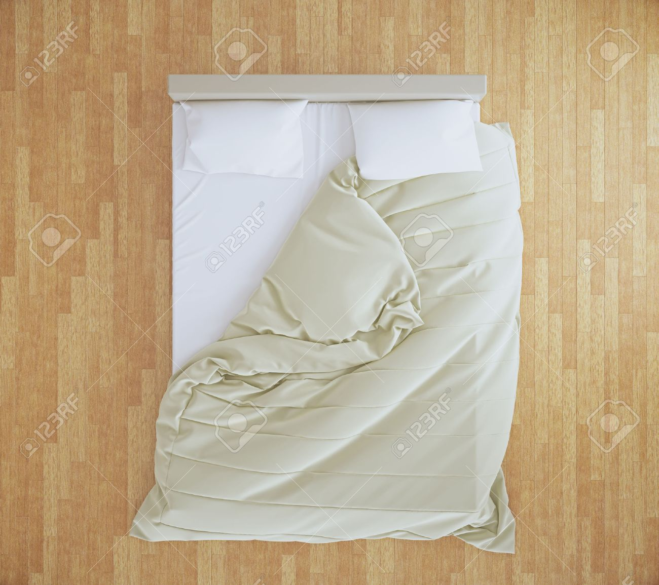 White bed top view - Top View Of An Unmade Bed With Beige Blanket And White Linens On Brown Wooden Floor