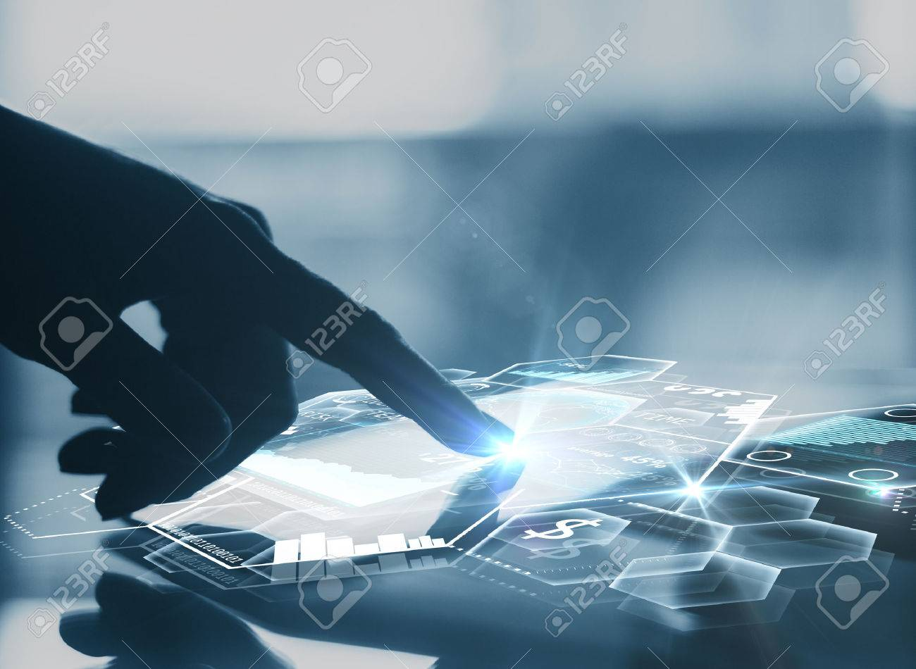 Side view of businessman's hand using tablet with abstract digital charts and honeycomb cells. Modern business technologies concept. 3D Rendering - 73462016