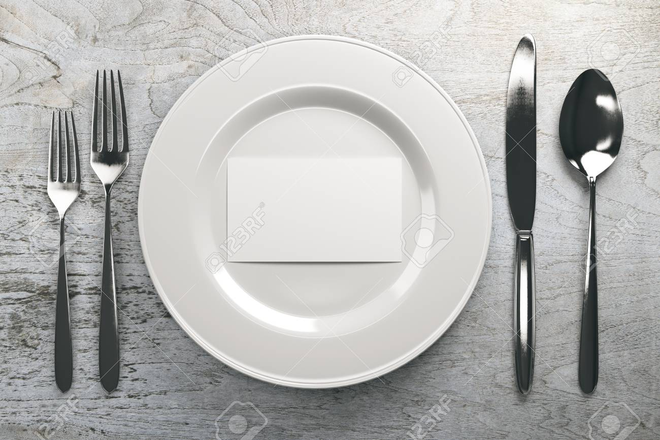 Top view of ceramic plate with empty business card and cutlery on grey wood table. Mock up, 3D Rendering - 76070943