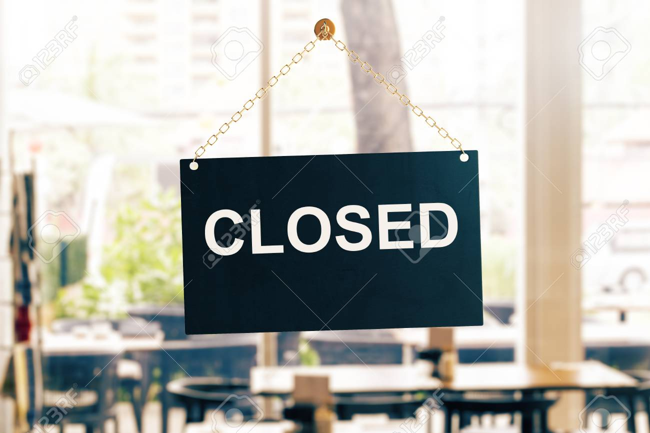 Close up of black closed sign hanging on glass door. Blurry background. Store working hours concept. 3D Rendering - 86055577
