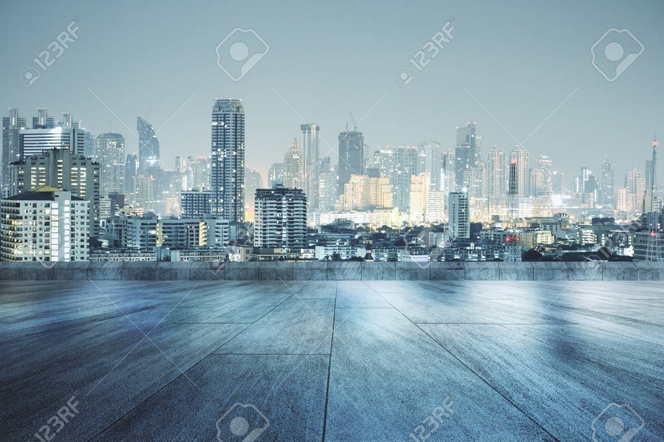 Concrete Rooftop With Beautiful Night City View Wallpaper Stock