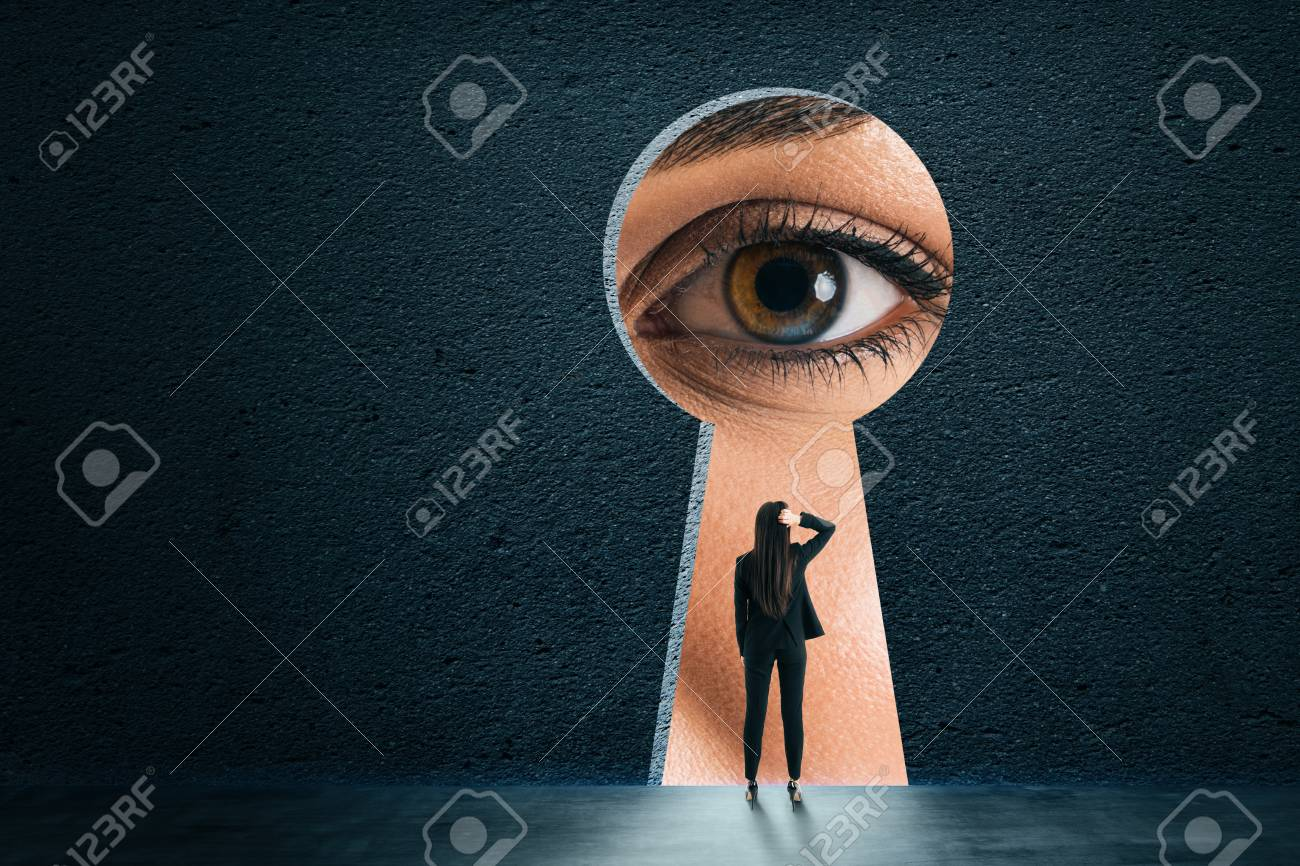Abstract keyhole opening with businesswoman eye on concrete wall background. Access and vision concept - 117608855