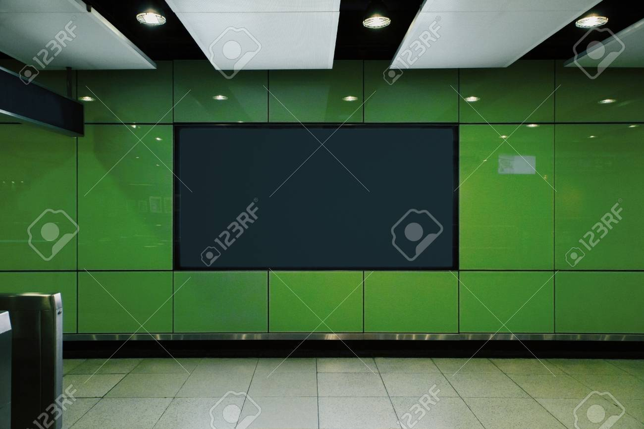 Front view of empty black poster in green underground subway station. Commercial and ad concept. Mock up - 118786930