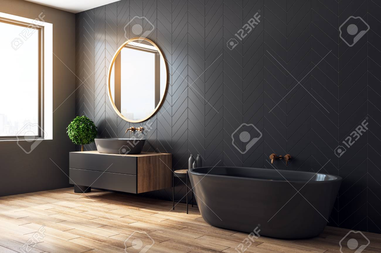 Side view of black orange bathroom interior with decorative tree, bath tub, sink, round mirror, sunlight and copy space. 3D Rendering - 119370519