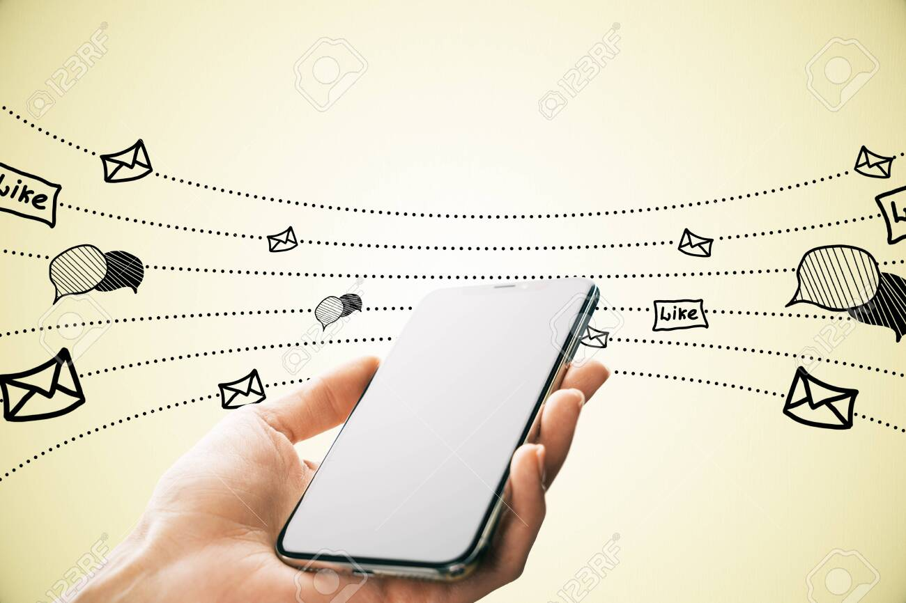 Hand holding smartphone with creative network sketch on yellow