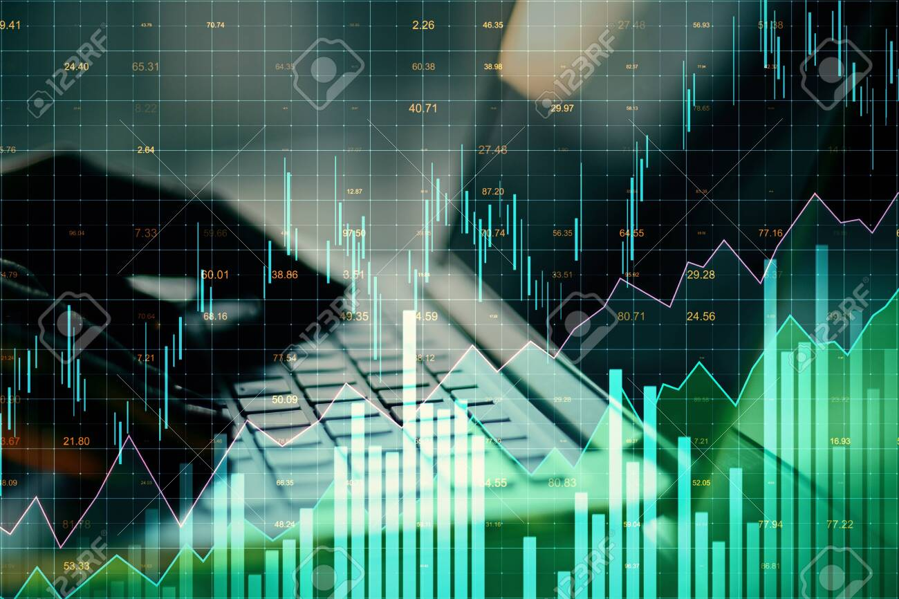 Close up of hands using laptop with glowing forex chart on blurry background. Invest and stats concept. Multiexposure - 123065402