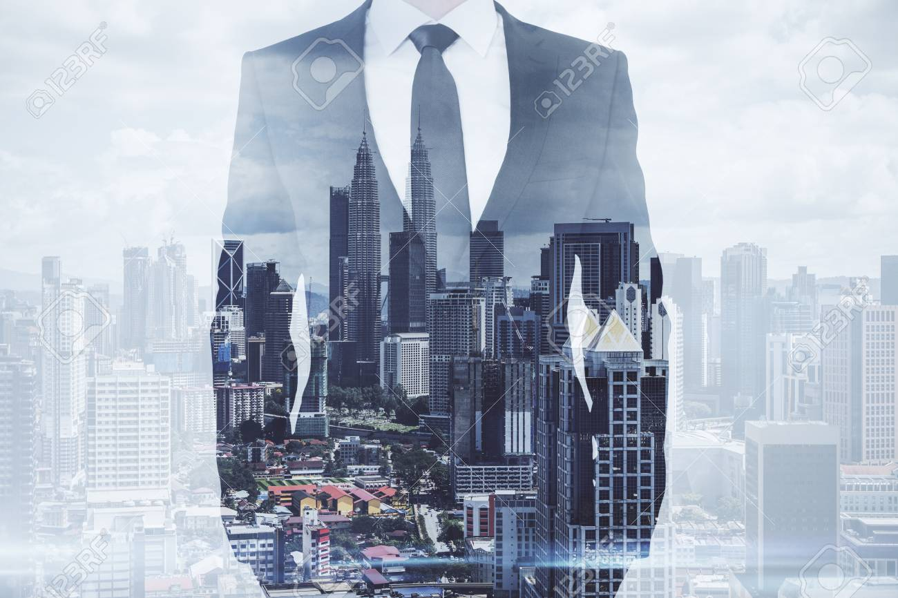 Businessman standing on creative Kuala Lumpur city background. Success and future concept. Double exposure - 123066615
