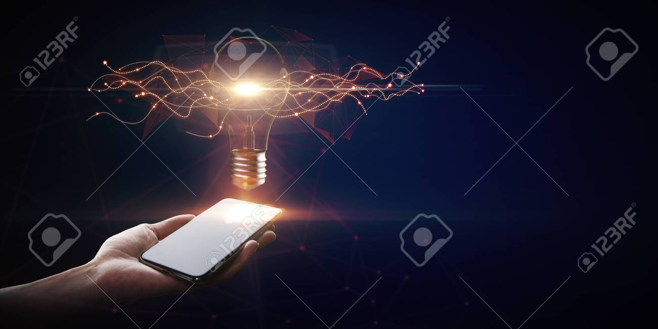 Hand holding smartphone with creative glowing lamp on dark background. Idea and innovation concept - 123559641