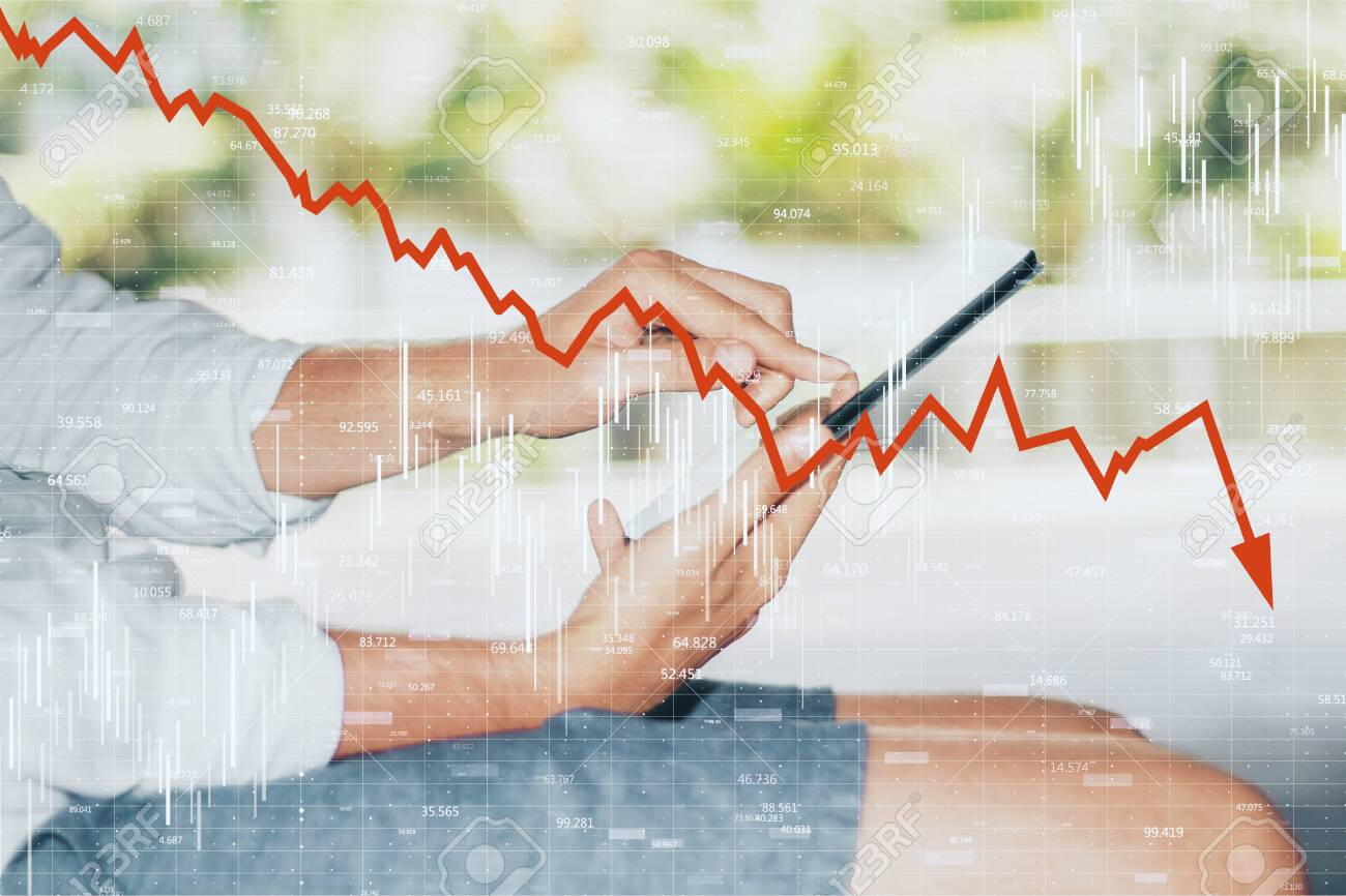 Close up and side view of hands using smartphone with downward red chart arrow. Decrease, internet and market concept. Double exposure - 127134822
