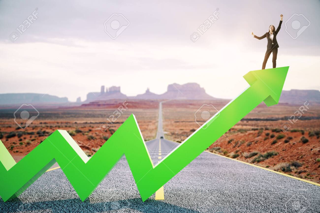 Happy businesswoman standing on upward green arrow on abstract road and desert background. Growth, development, success and increase concept. - 127355141
