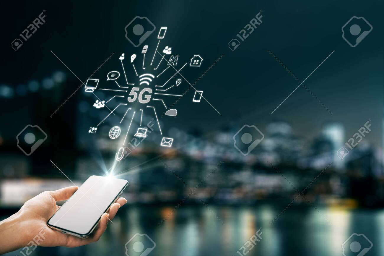 Hand using smartphone with abstract 5G interface with computing icons on blurry night city background. Internet speed and ai concept. Double exposure - 128286749